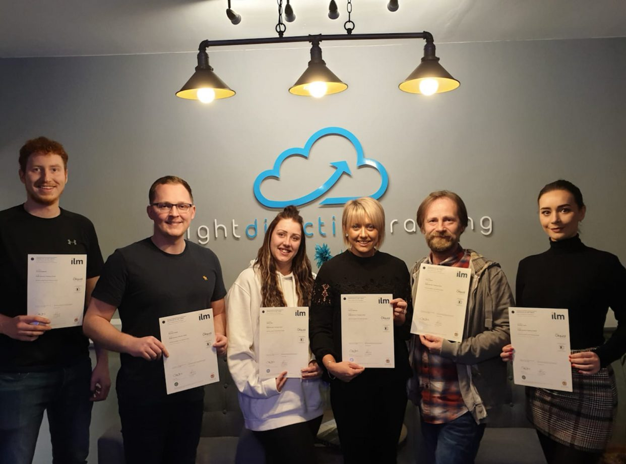 team leader apprenticeship learners with their certificates after passing the course by Bright Direction training